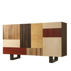 Part of the Patchwork collection designed by Maurizio Duranti, this striking piece is modern in its colors and silhouette, but evokes the art of mastering cabinet making. This unique cabinet features two drawers and four cabinet doors on its front, made of wenge, walnut, maple, padauk, ebony and cherry, for a playful and colorful effect that will make a statement in any room it is placed.