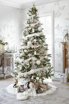 An indoor winter wonderland awaits you with Pier 1's Frosted Noel Christmas Tree. Branches sparkle with a touch of frost. A reindeer tree topper provides a personal touch. Frosty ornaments shimmer like icicles, while a faux fur tree skirt makes a cold day feel warm.