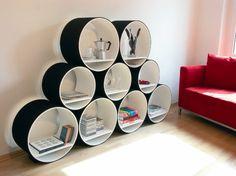 Another crazy idea. It is nice though    http://shoeboxdwelling.files.wordpress.com/2011/01/cshelf1.jpg
