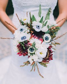 Gorgeous and very unique bridal bouquet! | http://www.weddingpartyapp.com/blog/2014/10/10/elegant-chapel-winery-wedding-rachel-may-photography/