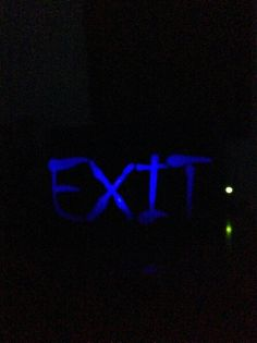 Haunt exit sign. Made from a cereal box and wax paper.
