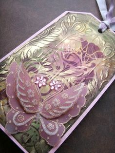 Tag Art using stencils, distress inks and Gem Stamp Cherry Blossom Butterfly