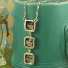 This is where I got my 4-kitty photo necklace - love PlanetJill.com!