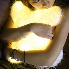 Diana Lin: 'd°light Huggable' Cushion, woven polyester and LED light. Power by plug via a 6 volt AC adapter, or use 4 AA batteries.  http://sclick.net/cool%20gadgets/coolest-newest-fun-high-tech-gadget/07/latest-fun-top-cool-new-high-technology-gadgets-d-light-pillow-2.jpg, #hudsonvalley #video #marketing