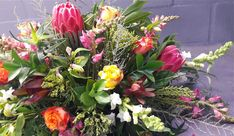 This beautiful mock-up is for Ashleigh's wedding in November. She wants brights but with lots of lush contrasting greens in between. As always we found a place for the lovely Protea Venus in the mix.