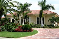tropical landscape island for front yard | Tropical Mediterranean paved circular driveway