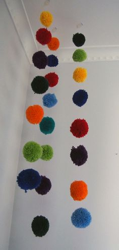 Wool pom pom decorations for a child's room. www.etsy.com/shop/Debsla