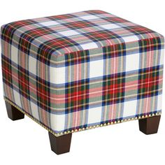 Upholstered in eye-catching plaid, this stylish ottoman makes a bold addition to the dining room or office.Product: Ottoman