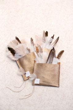Pretty feather toss instead of rice or glitter: http://www.stylemepretty.com/2016/03/17/trending-feather-wedding-details-that-soar-new-stylish-heights/