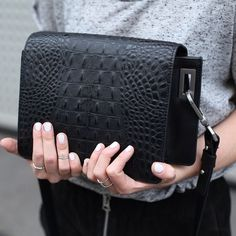 Versatile black snakeskin bag