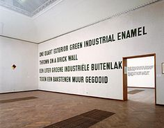 Lawrence Weiner: ONE QUART GREEN EXTERIOR INDUSTRIAL ENAMEL THROWN ON A BRICK WALL,  Concept Work Nr.002, 1968. Later realization as a bilingual text on a wall.