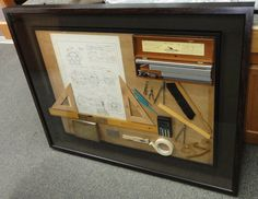 A complete drafters desk is now a piece of artwork for an engineering school.