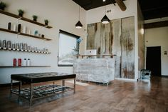 Barn door reception desk and metal wall