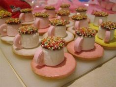 teacups! what a brilliant idea for a birthday party... tic toc biscuits topped with a marshmallow and then a chocolate freckle with a life saver cut in half for the handle.