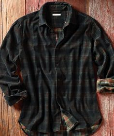 Carbon Cord Shirt  Cool yet cozy, our Carbon Cord Shirt starts with a yarn-dyed all cotton plaid corduroy in a rich olive plaid. We then mute the pattern by making the top corduroy layer a deep coal tone to create a sophistication and richness rarely found. Modern styling without pockets and a spread collar. Imported in Black/Olive plaid. Sizes S-XXL 133055 $89