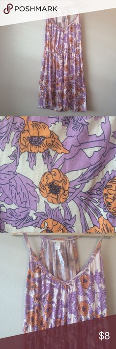 """H&M floral dress w orange & purple This dress runs very large. It could fit a large easily or a medium as a very flowy loose casual dress. It has an elastic waist band. It is size M.  Whimsical orange and purple flowers line this dress. Pair with a skinny belt and heels or a cardigan and flats.   Laying flat approx:pit to pit 22"""", waist 15"""", pit to bottom is 30"""" 100% viscose H&M Dresses"""