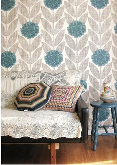 Orla Keily...love the print on the wall paper. Everything else is too shabby chic for my taste.
