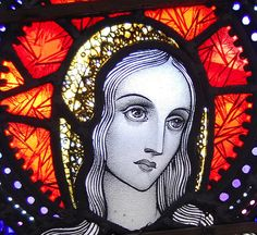 I believe this is stained glass by Harry Clarke an Irish artist known mainly for his black and white illustrations. Clarke was a leading figure in the Irish Arts and Crafts Movement (if you are not familiar with this movement, its nothing like it sounds.) via vi.sualize.us