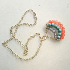 Silver, teal, and orange beaded necklace