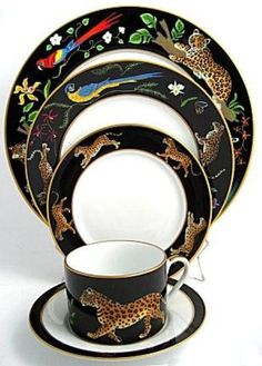 """""""Jaguar Jungle"""" place setting by Lynn Chase. I only have 6 place settings because its so expensive, but I love it!"""