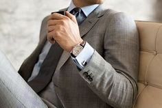 brown watch band, french cuffs, don't know the pattern on this suit, but I like the tone