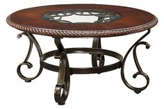 Reddish Brown Gambrey Coffee Table  Width: 38.25''Depth: 38.25''Height: 19.25