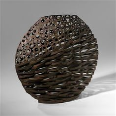 This cool wire vase is textually and visually beautiful, perfect for indoor and outdoor use.