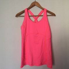Lululemon Tank Lululemon Tank with X elastic back straps, has built in bra support, does not come with breast pad inserts, brighter pinkish color with an orangish seaming. Beautiful fit and color! lululemon athletica Tops Tank Tops