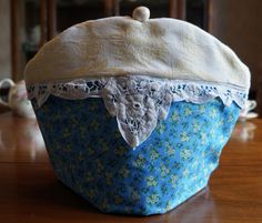 Shabby Chic Blue and Yellow Print Insulating Fabric Tea Cosy / Cozy with Battenberg Lace Trim and Custom Pearly Polymer Clay Bead Pull Top by TeaWithFriends on Etsy $50.00 CAD