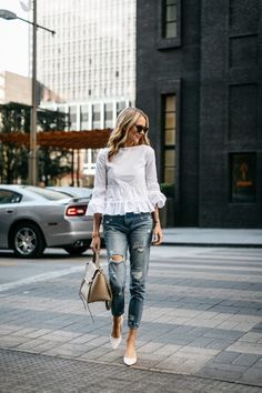 Amy Jackson is wearing a white cotton blend ruffle top with distressed jeans, a leather bag, and white pointed toe heels. Top: Club Monaco, Jeans: BlankNYC, Heels: Zara, Handbag: Celine, Sunglasses: Karen Walker c/0, Watch: Larsson & Jennings