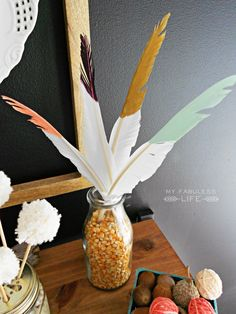 paint dipped feathers. Perfect fall craft!