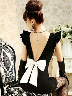 The back of this LBD is lovely...why they ho'd it up w/ leather gloves and fish net stockings is a mystery to me!
