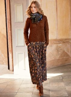 Coppery cloisonné flowers from an antique Limoges pocketwatch warm the navy ground of our viscose (95%) and elastane (5%) jersey maxi-skirt. The contoured yoke fits slim through the waist, releasing in front gathers to a full, sweeping hem; pockets.