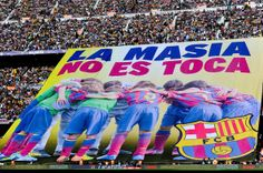 FC Barcelona display a large banner protesting against FIFA's decision to ban FC Barcelona signing players until summer 2015 before the La Liga match between FC Barcelona and Real Betis Balompie at Camp Nou on April 5, 2014 in Barcelona, Catalonia.