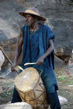 Pictures of Mali - Dogon Dance - a drummer accompanies the dancing