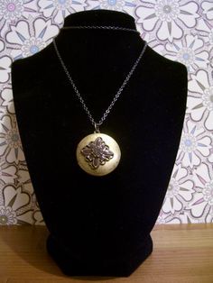"""A beautiful vintage inspired locket hangs from a gunmetal chain. Locket opens to hold 2 photographs.    Length: 20""""  Lobster clasp    $25  ~SOLD~"""