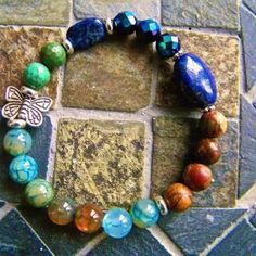 """""""Transitions"""", a handmade bracelet that parallels life in that there are many sudden and abrupt changes/losses that either we adjust to, or never grow to become butterflies…. ON SALE"""