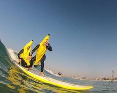 Nicole Mendoza and Katie Dill 'ripe' where they want to be during the Blackies annual Halloween costume surf in Newport Beach, CA. Photo by Maddy Post.