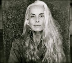 """It took me a few minutes but I discovered the name of """"that grey-haired model for Eileen Fisher"""" (at first all the info I could find). It is Yasmina Rossi. How gorgeous is she? She is in her 50's and she defies all the traditional wisdom about aging gracefully...i.e., long hair in general, but particularly long grey hair will age a woman. I hope I look this good at Yasmina's age."""