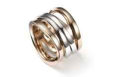 Ring from Mattioli's Aspis collection featuring two rows of white gold and two rows of rose gold.