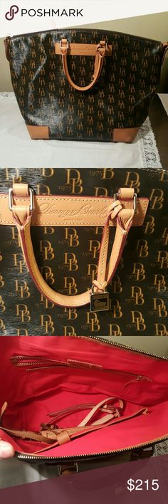 Dooney & bourke XL Vanessa satchel crossbody Like new. All 4 of the leather corners are discolored from storage and natural aging. Retired & hard to find Vanessa satchel. Coated canvas & leather. Extra large in size. Smoke free pet free home Dooney & Bourke Bags Satchels