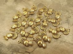 Twenty (20) Gold Tone Pewter Charms - KNIGHT'S HELMET  - 5066
