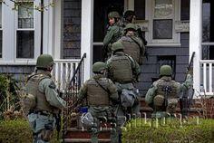SWAT Teams searching homes