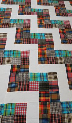 Lovely plaid scrappy. Consider it as a 9patch,,,only 3 of the patches on one side is a solid white.