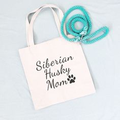 Siberian Husky Mom Tote Bag. These simply designed canvas tote bags will be the shopping bag you reach for time and time again. They are roomy enough to hold all your essentials but not so large that you feel like you're lugging a suitcase around. Made from lightweight cotton canvas, they are not only durable but both classic and trendy. 10% of your purchase is donated to help dogs in need at local animal shelters. Dog Mom Gifts, Dog Lover Gifts, Dog Lovers, Diamond Dogs, Crazy Dog, Dog Accessories, Canvas Tote Bags, My Best Friend, I Am Awesome