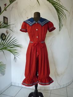 Rare antique swimwear, ca. 1895. The fabric, a wool cotton blend most likely, is a deep rich red and blue (striped).