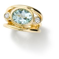 Cassandra Goad: Aeneus18ct yellow gold ring set with facetted oval cut soft blue aquamarine and diamonds. GBP4,980.00