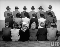 Macy's department store detectives posing for a picture with their backs turned so as not to reveal their identity. December 1948.