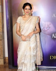 The notably talented #Sridevi compels us to say 'Wow' everytime, we catch a glimpse of her. Lace, pearls, jasmine and everything nice! A #saree does not need a lot of #accessories, as you can see an elegant clutch, pearls and a winning smile is all you need, to look like a diva.