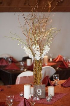 Centerpieces with Table numbers spray painted on recycled wood from an old barn - Fall Wedding Ideas